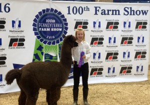 Grace posing with her first place ribbon.