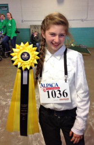 Julia poses with her fifth place ribbon.