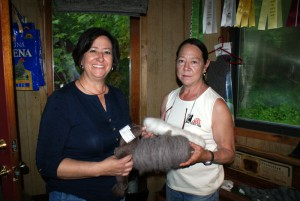 Sandy shows Marcy some rovings from our alpacas.