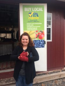 Amy of Pennsburg shows off the fingerless gloves she selected as winner of our Guess the Corks Contest. Congratulations, Amy.