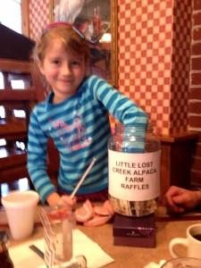Our granddaughter Maggie picks the winner of the Best Kept Secrets $50 raffle.